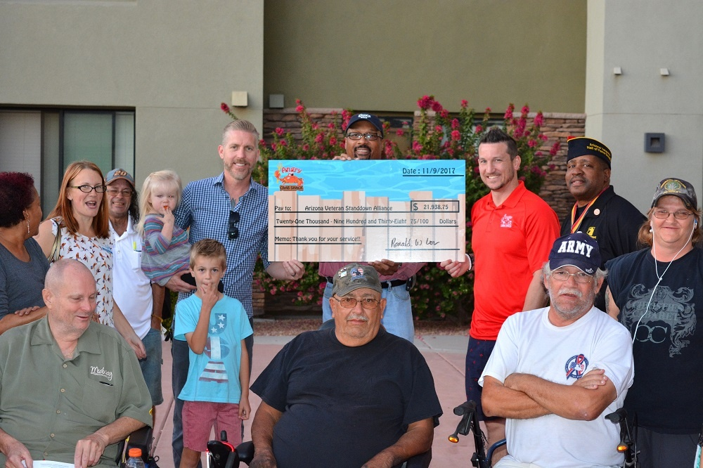 Angry Crab presents check to Arizona Veteran StandDown Alliance